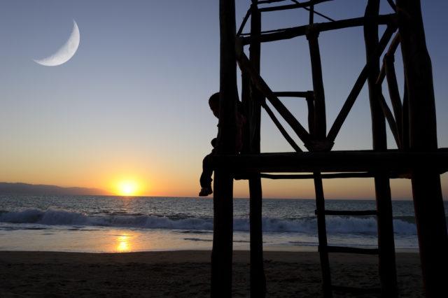 shutterstock_moon-sun-beach