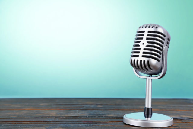 shutterstock_microphone aqua background